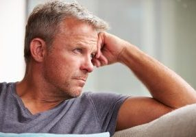 Mature Man Suffering From Depression At Home